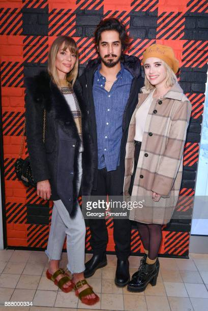 Actors Jaime King Avan Jogia and Emma Roberts attend Woolrich Yorkdale Grand Opening at Yorkdale Shopping Center on December 7 2017 in Toronto Canada