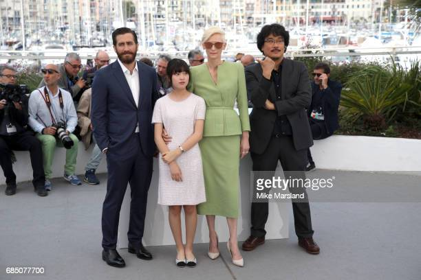 Actors Jake Gyllenhaal Ahn SeoHyun director Bong JoonHo and actress Tilda Swinton attend the 'Okja' photocall during the 70th annual Cannes Film...