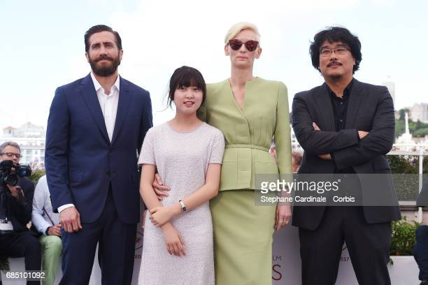 Actors Jake Gyllenhaal Ahn SeoHyun Tilda Swinton and director Bong JoonHo attend the 'Okja' photocall during the 70th annual Cannes Film Festival at...