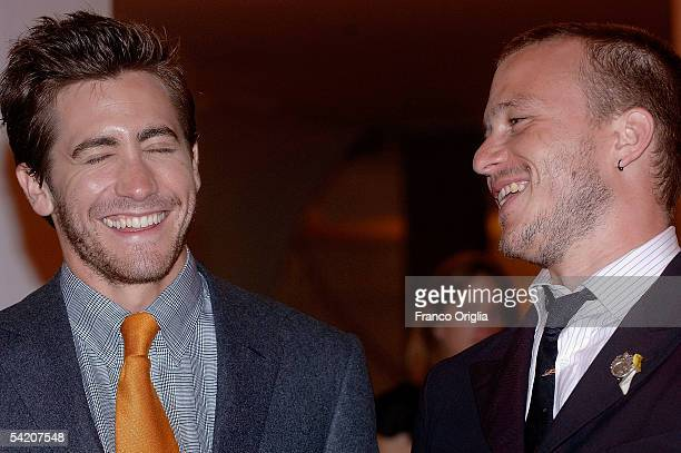 Actors Jake Gyllenhaal and Heath Ledger share a joke at the premiere for the incompetition film Brokeback Mountain at the Palazzo del Cinema on the...