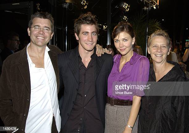 Actors Jake Gyllenhaal and sister Maggie Gyllenhaal pose with parents Steve Gyllenhaal and Naomi Foner at a benefit screening of Touchstone Pictures'...