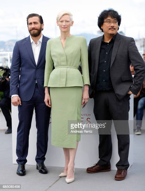 Actors Jake Gyllenhaal Tilda Swinton and Director Bong JoonHo attend the Okja photocall during the 70th annual Cannes Film Festival at Palais des...