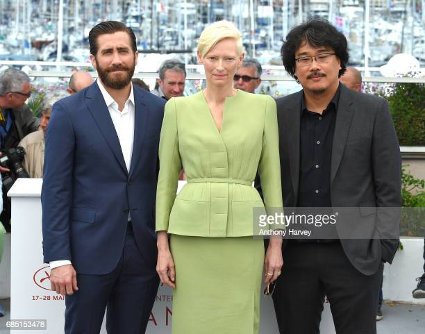 Actors Jake Gyllenhaal Tilda Swinton and director Bong JoonHo attend the 'Okja' Photocall during the 70th annual Cannes Film Festival at Palais des...