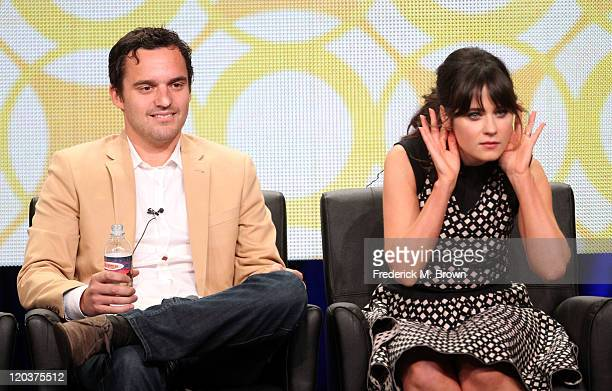 """Actors Jake Johnson and Zooey Deschanel speak onstage at """"New Girl"""" panel during the FOX portion of the 2011 Summer TCA Tour at the Beverly Hilton..."""