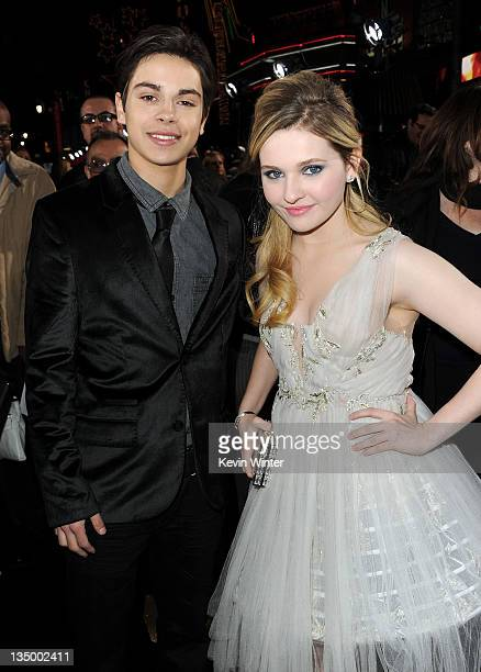 Actors Jake T Austin and Abigail Breslin arrive at the premiere of Warner Bros Pictures' 'New Year's Eve' at Grauman's Chinese Theatre on December 5...