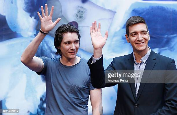 Actors James and Oliver Phelps attend the press conference for the exhibition 'Harry Potter The Exhibition' on April 4 2014 in Cologne Germany The...