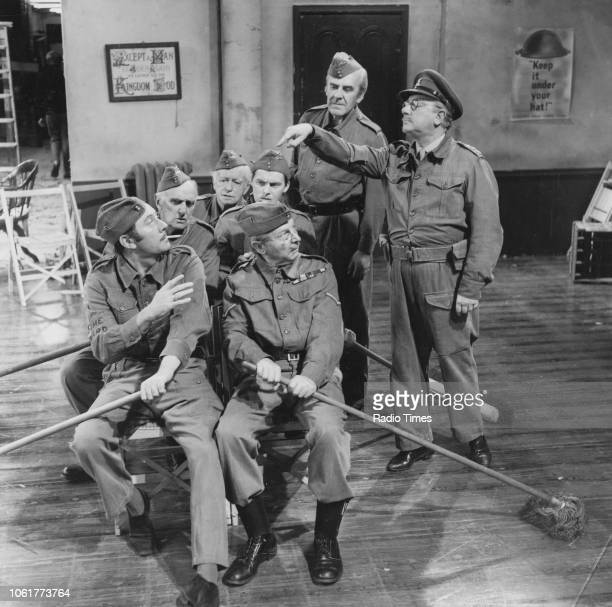 Actors James Beck John Laurie and Arnold Ridley with Clive Dunn Ian Lavender John Le Mesurier and Arthur Lowe in a scene from episode 'Sons of the...
