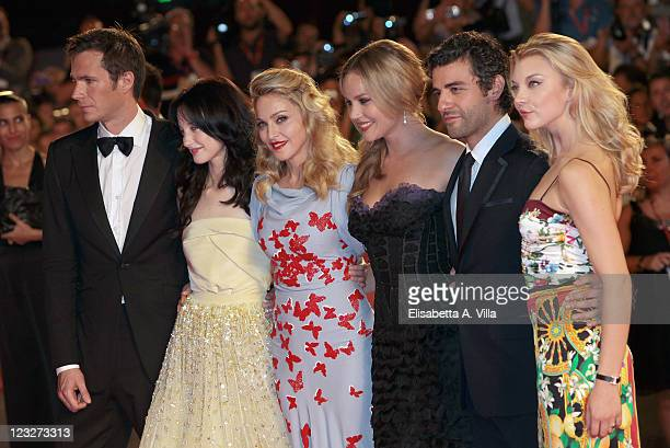 Actors James D'Arcy, Andrea Riseborough and Madonna with Abbie Cornish, Oscar Isaac, Natalie Dormer attend the 'W.E.' premiere at the Palazzo Del...