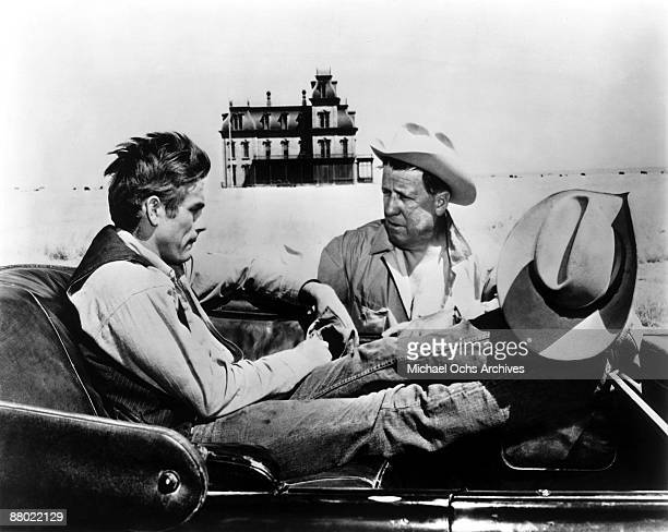 Actors James Dean and Chill Wills pose for a photo on the set of the Warner Bros film 'Giant' in 1955 in Marfa Texas