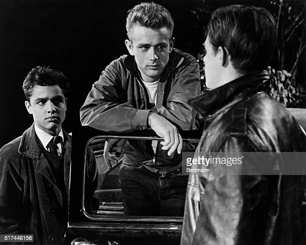Actors James Dean and Sal Mineo with another actor in a scene from Rebel Without a Cause