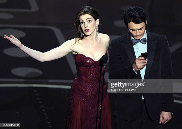 Actors James Franco and Anne Hathaway present the 83rd Annual Academy Awards at the Kodak Theatre late on February 27 2011 in Hollywood California...