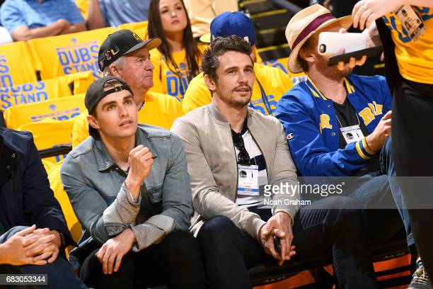 Actors James Franco and Dave Franco are seen at the game between the Golden State Warriors an the San Antonio Spurs during Game One of the Western...