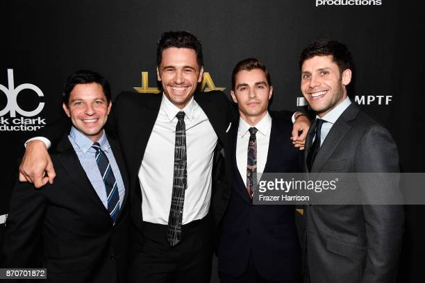 Actors James Franco and Dave Franco pose with honorees Scott Neustadter and Michael H Weber recipients of the Hollywood Screenwriter Award for 'The...