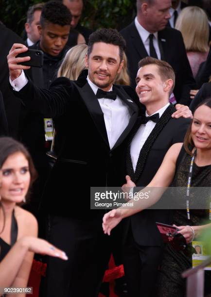 Actors James Franco and Dave Franco take a selfie at The 75th Annual Golden Globe Awards at The Beverly Hilton Hotel on January 7 2018 in Beverly...