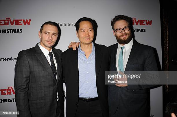 """Actors James Franco, Charles Rahi Chun and Seth Rogen arrive at the premiere of """"The Interview"""" held at The Theater at Ace Hotel."""