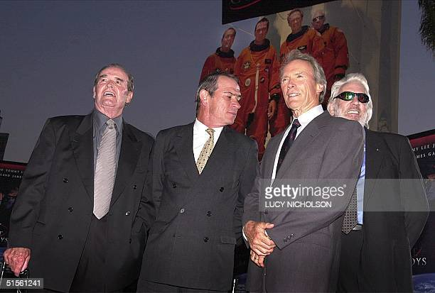 US actors James Garner Tommy Lee Jones Clint Eastwood and Donald Sutherland pose as they arrive at the premiere of their new film Space Cowboys in...