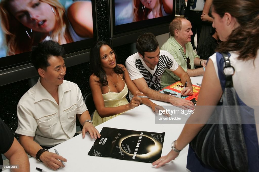 Actors James Kyson Lee, Dania Ramirez and Zachary Quinto sign autographs for fans at the NBC Universal celabration for the DVD realease of 'Heroes: Season 1' at the NBC Experience store on August 28, 2007 in New York City.