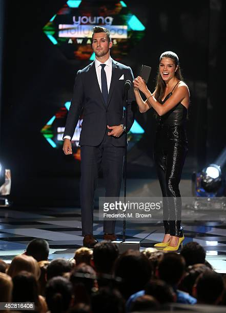 Actors James Maslow and Marie Avgeropoulos speak onstage at the 2014 Young Hollywood Awards brought to you by Samsung Galaxy at The Wiltern on July...