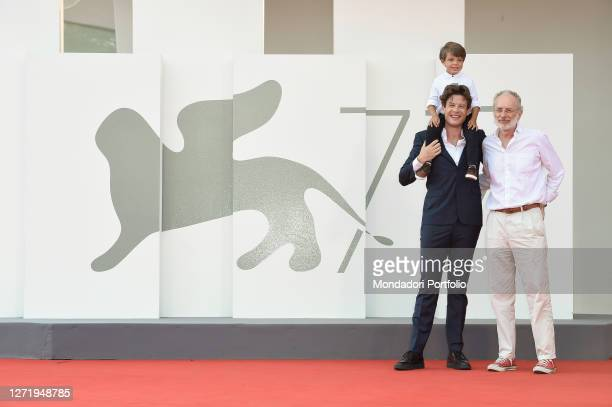 Actors James Norton and Michael Lamont with director Uberto Pasolini at the 77 Venice International Film Festival 2020. Nowhere Special red carpet....