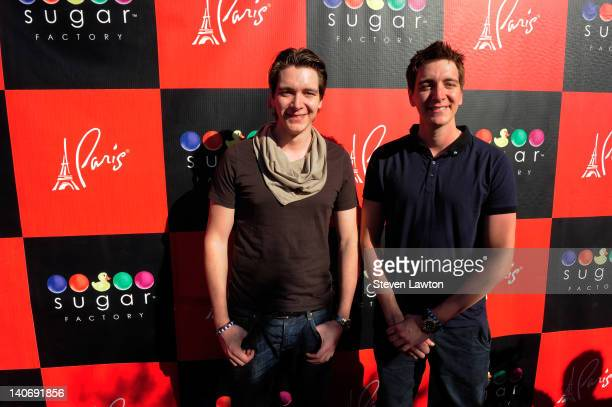 Actors James Phelps and Oliver Phelps arrive for an autograph signing at the Sugar Factory American Brasserie at the Paris Las Vegas on March 4 2012...