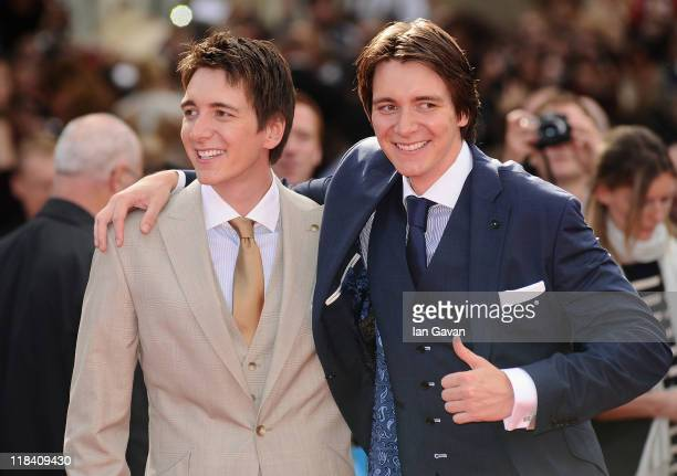Actors James Phelps and Oliver Phelps attend the World Premiere of Harry Potter and The Deathly Hallows Part 2 at Trafalgar Square on July 7 2011 in...