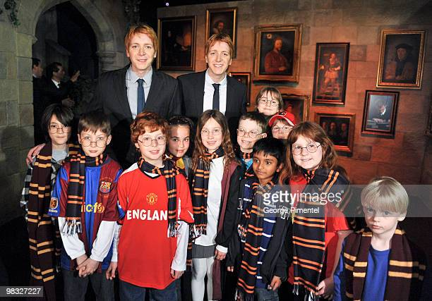 Actors James Phelps Oliver Phelps and students attend Harry Potter The Exhibition at the Ontario Science Centre on April 8 2010 in North York Canada