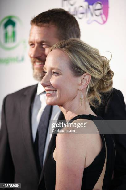 Actors James Tupper and Anne Heche arrive at THE IMAGINE BALL at House of Blues Sunset Strip on August 6 2014 in West Hollywood California