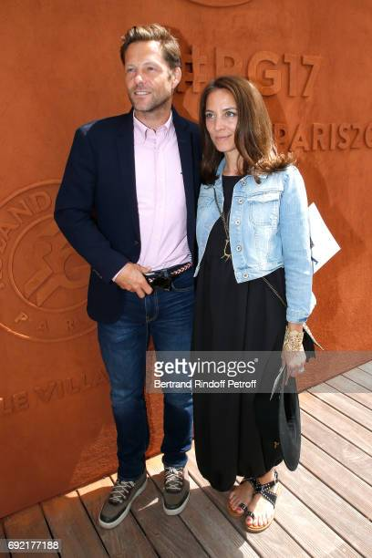 Actors Jamie Bamber and his wife Kerry Norton attend the 2017 French Tennis Open Day Height at Roland Garros on June 4 2017 in Paris France