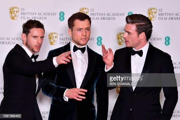 Actors Jamie Bell Taron Egerton and Richard Madden pose in the winners room at the BAFTA British Academy Film Awards at the Royal Albert Hall in...
