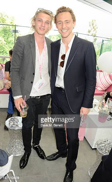 Actors Jamie Campbell Bower and Tom Hiddleston attend the evian 'Live young' VIP Suite at Wimbledon on June 25, 2012 in London, England.