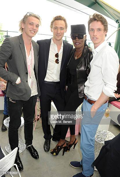 Actors Jamie Campbell Bower, Tom Hiddleston, singer Grace Jones and actor Eddie Redmayne attend the evian 'Live young' VIP Suite at Wimbledon on June...