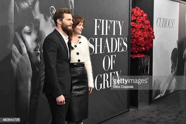Actors Jamie Dornan and Dakota Johnson attend the Fifty Shades Of Grey New York Fan First screening at Ziegfeld Theatre on February 6 2015 in New...