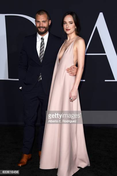 Actors Jamie Dornan and Dakota Johnson attend the premiere of Universal Pictures' Fifty Shades Darker at The Theatre at Ace Hotel on February 2 2017...