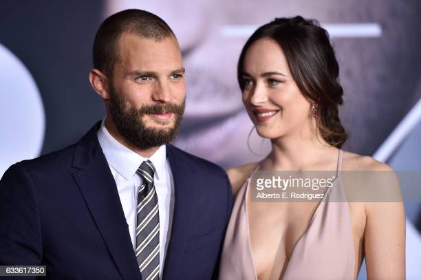 Actors Jamie Dornan and Dakota Johnson attend the premiere of Universal Pictures' 'Fifty Shades Darker' at The Theatre at Ace Hotel on February 2...