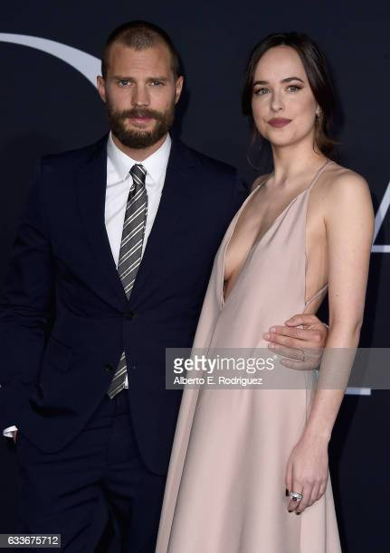 Actors Jamie Dornan and Dakota Johnson attends the premiere of Universal Pictures' 'Fifty Shades Darker' at The Theatre at Ace Hotel on February 2...