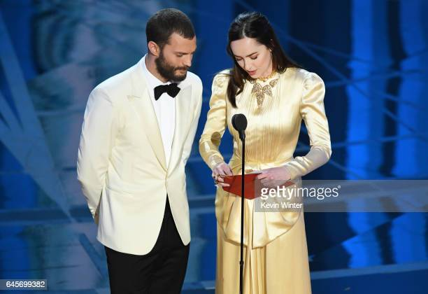 Actors Jamie Dornan and Dakota Johnson speak onstage during the 89th Annual Academy Awards at Hollywood Highland Center on February 26 2017 in...