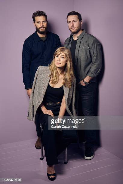 Actors Jamie Dornan Rosamund Pike and filmmaker Matthew Heineman from the film 'A Private War' pose for a portrait during the 2018 Toronto...
