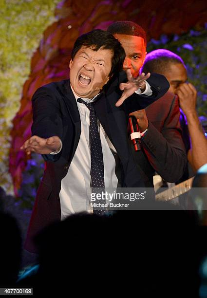 Actors Jamie Foxx and Ken Jeong perform onstage at Hollywood Stands Up To Cancer Event with contributors American Cancer Society and Bristol Myers...