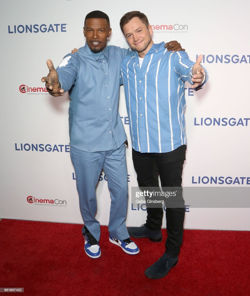 Actors Jamie Foxx (L) and Taron Egerton attend CinemaCon 2018 Lionsgate Invites You to An Exclusive Presentation Highlighting Its 2018 Summer and Beyond at The Colosseum at Caesars Palace during CinemaCon, the official convention of the National Association of Theatre Owners, on April 26, 2018 in Las Vegas, Nevada.