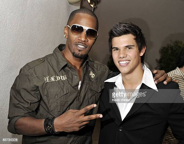 Actors Jamie Foxx and Taylor Lautner pose at the afterparty for the premiere of Summit Entertainment's Twilight at the Armand Hammer Museum on...