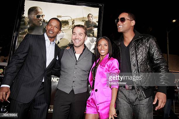Actors Jamie Foxx Jeremy Piven Jada Pinkett Smith and Will Smith pose at the premiere of Universal Picture's The Kingdom at the Mann's Village...