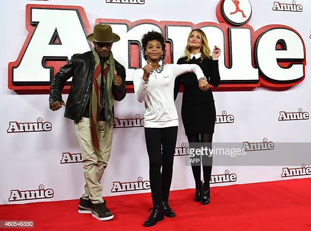 """Actors Jamie Foxx , Quvenzhane Wallis and Cameron Diaz pose for pictures during a photocall for the film """"Annie"""" in central London on December 16,..."""