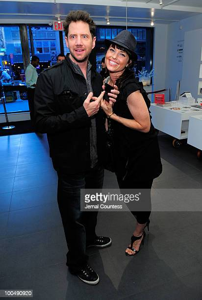 Actors Jamie Kennedy and Donnamarie Recco share photos at a screening of Finding Bliss at the Museum of Sex on May 24 2010 in New York City