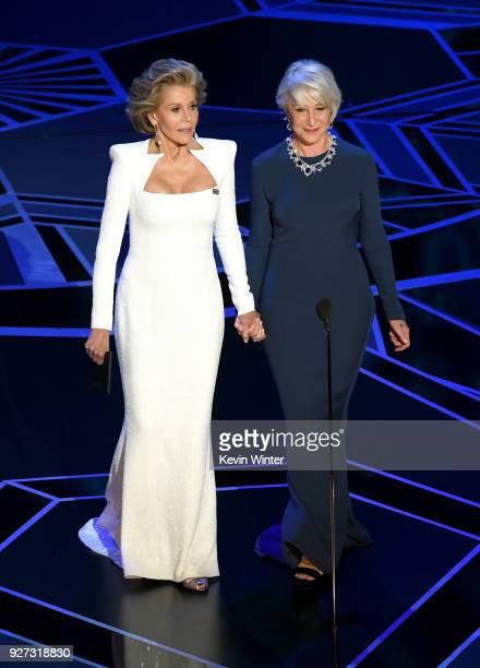 Actors Jane Fonda and Helen Mirren walk onstage during the 90th Annual Academy Awards at the Dolby Theatre at Hollywood Highland Center on March 4...