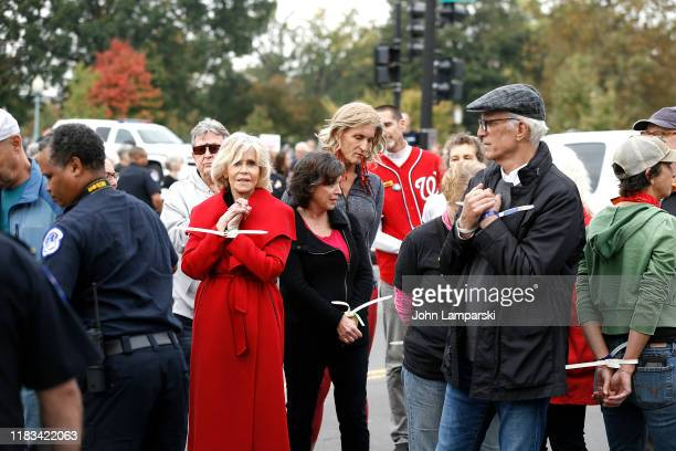 Actors Jane Fonda and Ted Danson are arrested during the Fire Drill Friday Climate Change Protest on October 25 2019 in Washington DC Protesters...
