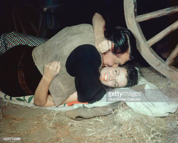 Actors Jane Russell as Nella Turner and Clark Gable as Colonel Ben Allison in a scene from the western film 'The Tall Men' 1955