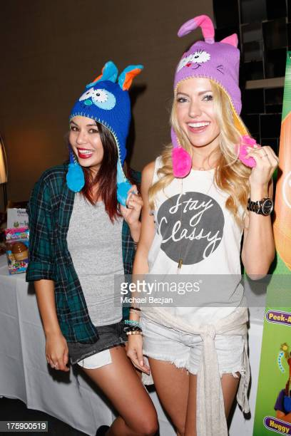 Actors Janel Parrish and Lindsay Taylor pose with Flipeez At KIIS FM Pre-Teen Choice Awards Gifting Suite on August 9, 2013 in Los Angeles,...