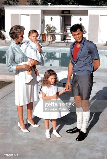 Actors Janet Leigh and Tony Curtis play with their daughters daughters Jamie Lee Curtis and Kelly Curtis by the pool at home on April 4, 1960 in Los...