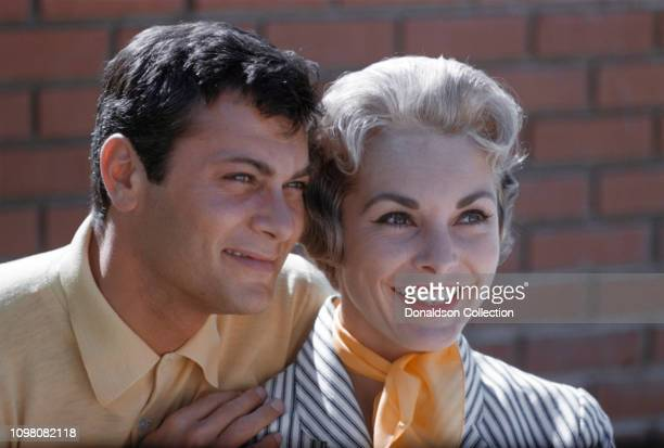 Actors Janet Leigh and Tony Curtis pose for a portrait in 1960 in Los Angeles, California.