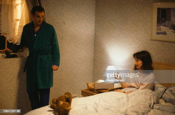 Actors Janine Duvitski and Angus Deayton in a bedroom scene from episode 'Warm Champagne' of the BBC Television sitcom 'One Foot in the Grave'...